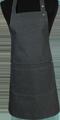 Detail foto van Halterschort voorzien van een verstelbare nekband d.m.v. drukkers. Zak dubbel opgestikt en in 2e gedeeld. Voorzien van rivetten. - Black zilver
