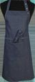 Detail foto van Halterschort voorzien van 2 locknaden met zak ertussen. Dubbel doorgestikt. Extra lange strikbanden. Verstelbare nekband d.m.v. drukkers. - Blue zilver